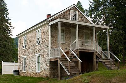 Stairs lead visitors up to the entrance of the historic Paymaster's Cabin in Pine Grove Furnace State Park.