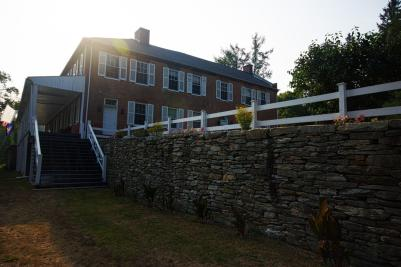 A stone terrace leads to the main entrance of Ironmaster's Mansion in Pine Grove Furnace State Park.