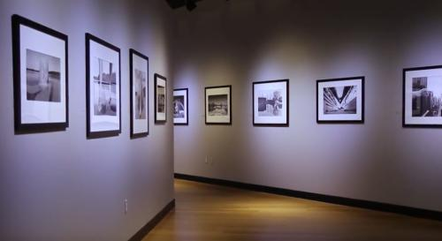 An exhibit hangs on the wall at Southeast Museum of Photography