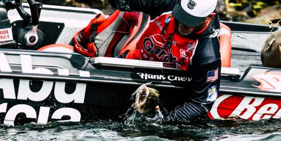 Man Pulling A Fish Out Of The Water On Ray Roberts Lake During Bassmaster