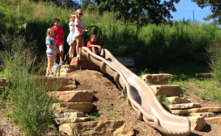 slide built into the side of a hill at nature play at Behringer-Crawford Museum in covington ky