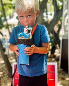 Little boy enjoying a blue Cookie Monster shake at PG Social House in Punta Gorda Florida