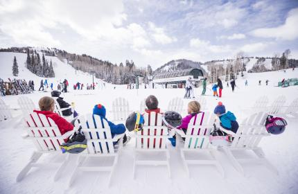 Family sitting at Ski Beach at Deer Valley Resort