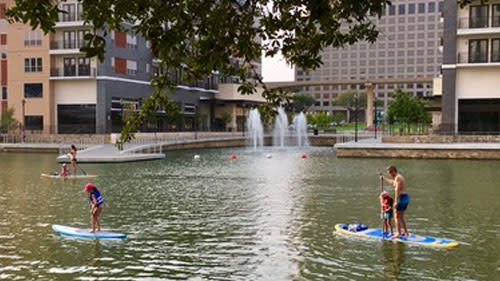Stand up paddle boarding with kids in Irving, TX