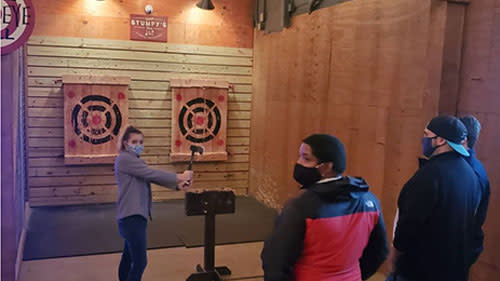 Teens throwing axes at Stumpy's Hatchet House in Irving, TX