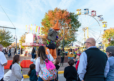 A stilt walker dressed as a scarecrow at the Clayton Harvest Festival in Johnston County, NC.