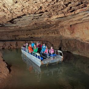 People on the underground boat ride at Indiana Caverns