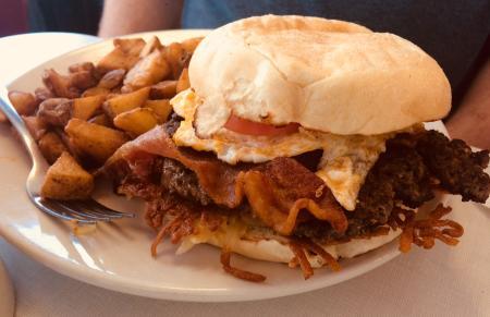 The Oasis Diner Brunch Burger is loaded with flavor!