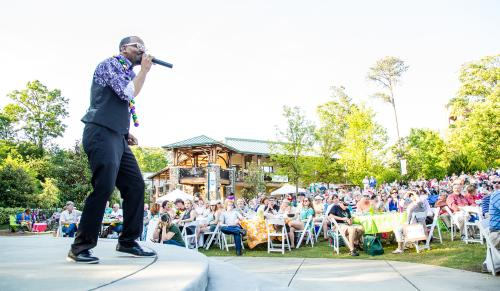 Singer on stage at the Heritage Sandy Springs outdoor concert series, Concerts by the Springs.