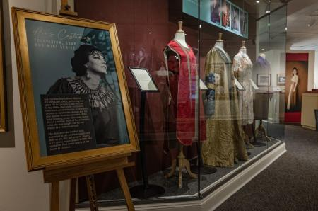 Interior photo of the Ava Gardner museum featuring the exhibit case about Ava's television costumes.