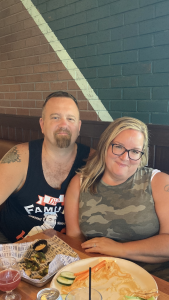 Two individuals dining at Northern Tap House