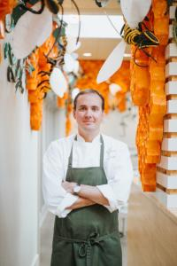 The Hive's Executive Chef Matthew McClure poses in the restaurant