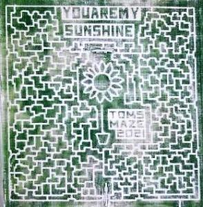 """Tom's Maze 2021, sunflower with words """"You Are My Sunshine"""""""