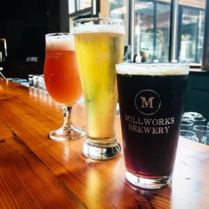 Dark and light beers poured in glasses from The Millworks
