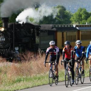 bike riders and the train