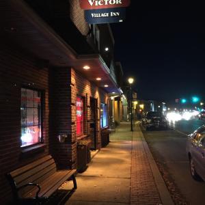 Exterior shot of Victor Village Inn at night