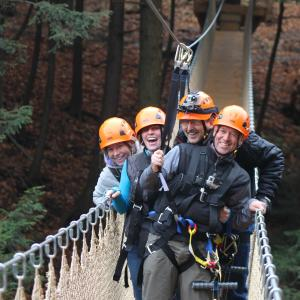 A group on a bridge at Bristol Mountain Aerial Adventures