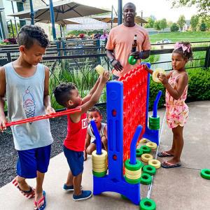 family-playing-at-pinstripes