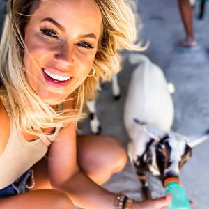 katie-starts-in-overland-park-feeding-goat