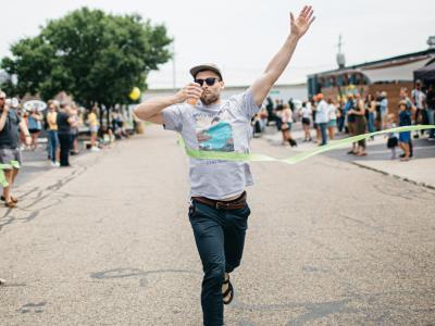 Winner crosses the finish line of the Four Peel Fest 0.5K