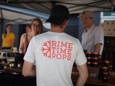 Man in Rime Time Pops shirt