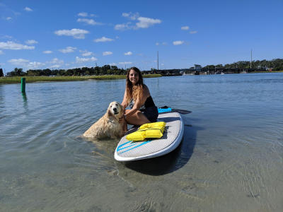 Paddleboarding with dog in Wrightsville Beach