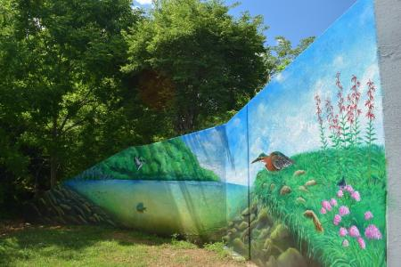 A colorful mural decorates a section of path along the Ten Mile Creek Greenway near Knoxville, TN.