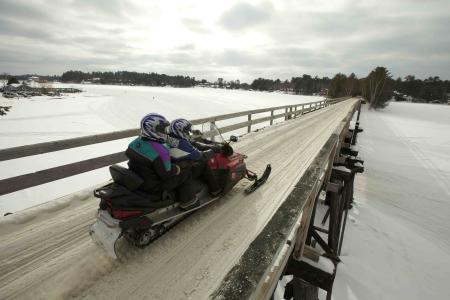 Snowmobile on bridge