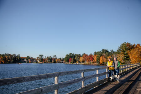 Joggers With Dog on Bridge in Minocqua