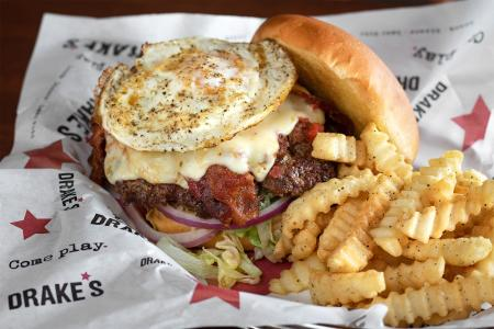 cheeseburger with fried egg and side of fries from drake's florence ky