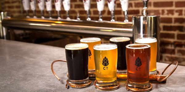 Six beers of various styles in front of the tap at Goshen Brewing Company