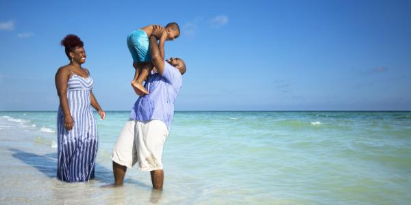 Parents Playing with Child on the Beach