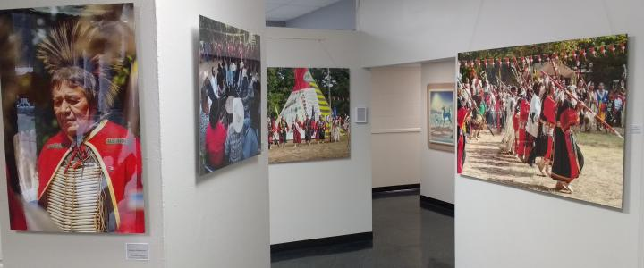 Photography and paintings hanging in the Red Earth Art Center