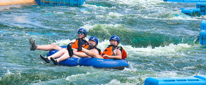 A group enjoys tubing down the white-water rapids at RIVERSPORT in OKC.