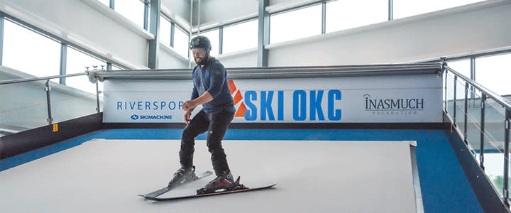 A visitor enjoy the experience of learning to ski on a man-made simulator at OKC's RIVERSPORT