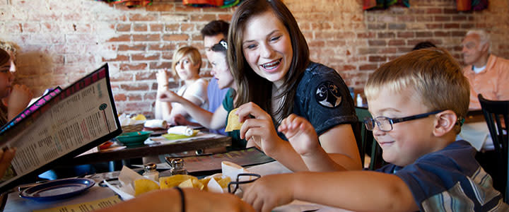 Young woman and little boy eating chips at an OKC restaurant
