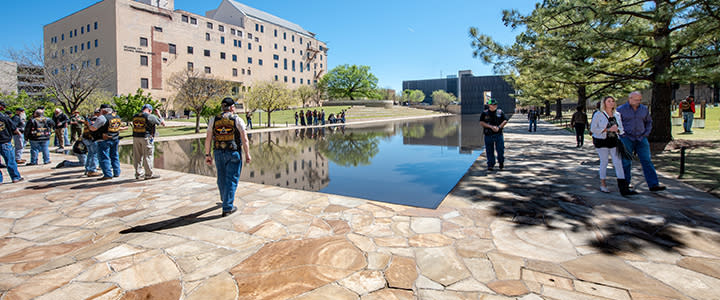 Locals and visitors walking around Oklahoma City Outdoor Symbolic Memorial