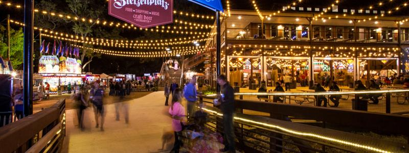 Beautifully lit Wurstfest entrance in New Braunfels, Texas