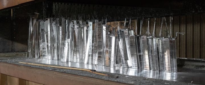 Metal bleacher parts being manufactured