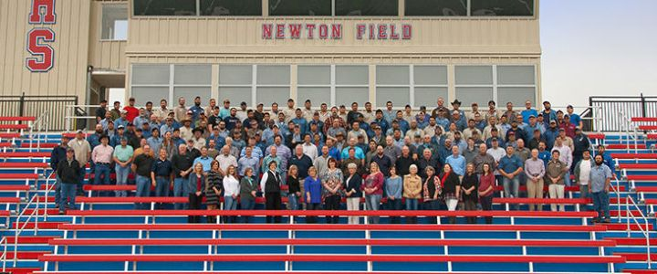 The staff of Southern Bleacher Co. assembled on the bleachers at Newton Field