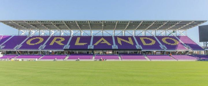 Purple bleachers with yellow seats spelling Orlando at Orlando City Stadium by Southern Bleacher Co.