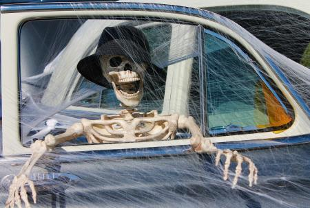 Skelton in a car