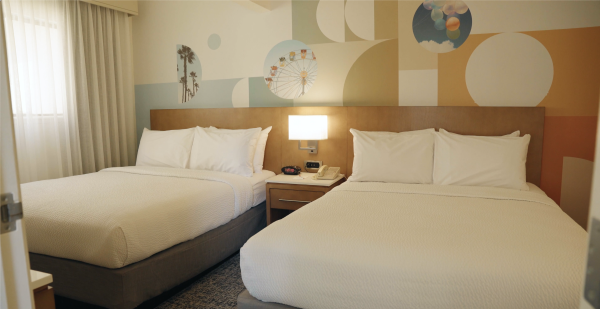 Image of two queen beds at Clementine Hotel & Suites