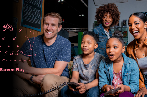 Family of five playing video games on a couch