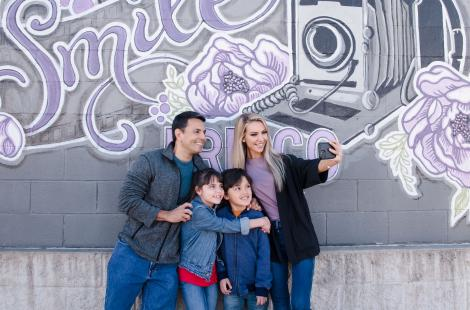 Family at Mural in the Rail District