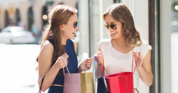 Women smiling with shopping bags