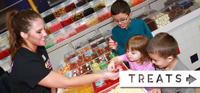 Woman selling Sweets and Treats to kids at the Albanese Candy Factory