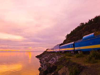 Alaska Railroad train on Turnagain Arm at sunset near Anchorage, Alaska