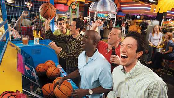 Guys playing pop a shot basketball