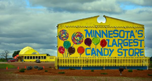 Large yellow barn that is a candy store